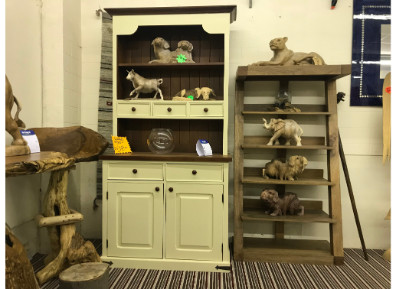 Bookcases of wooden animal statues