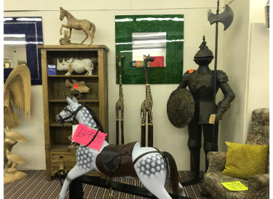 Rocking Horse and a suit of armour in our Morley showroom