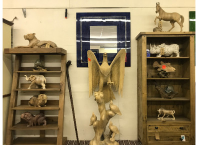 Selection of carved wooden animals in our showroom