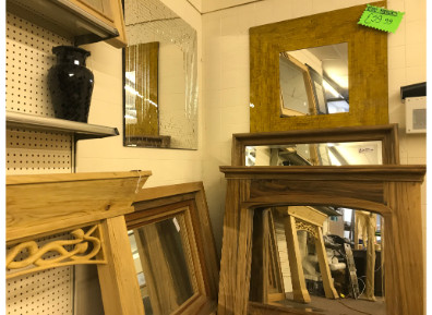 Wooden fireplaces and mirrors in our Morley showroom